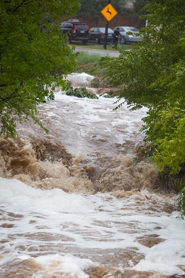 The river flowing down the middle of Table Mesa Drive in south Boulder,