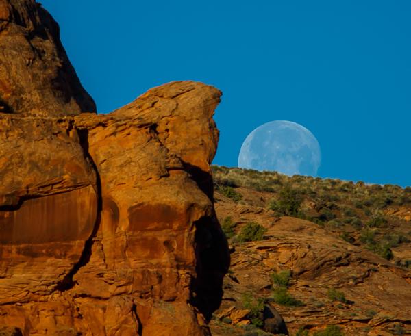Full Moon Setting over Red Rocks in Moab, Utah