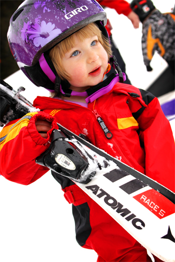 Ori holding racing skis - Age 3