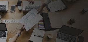 paperwork-team-computers-dark