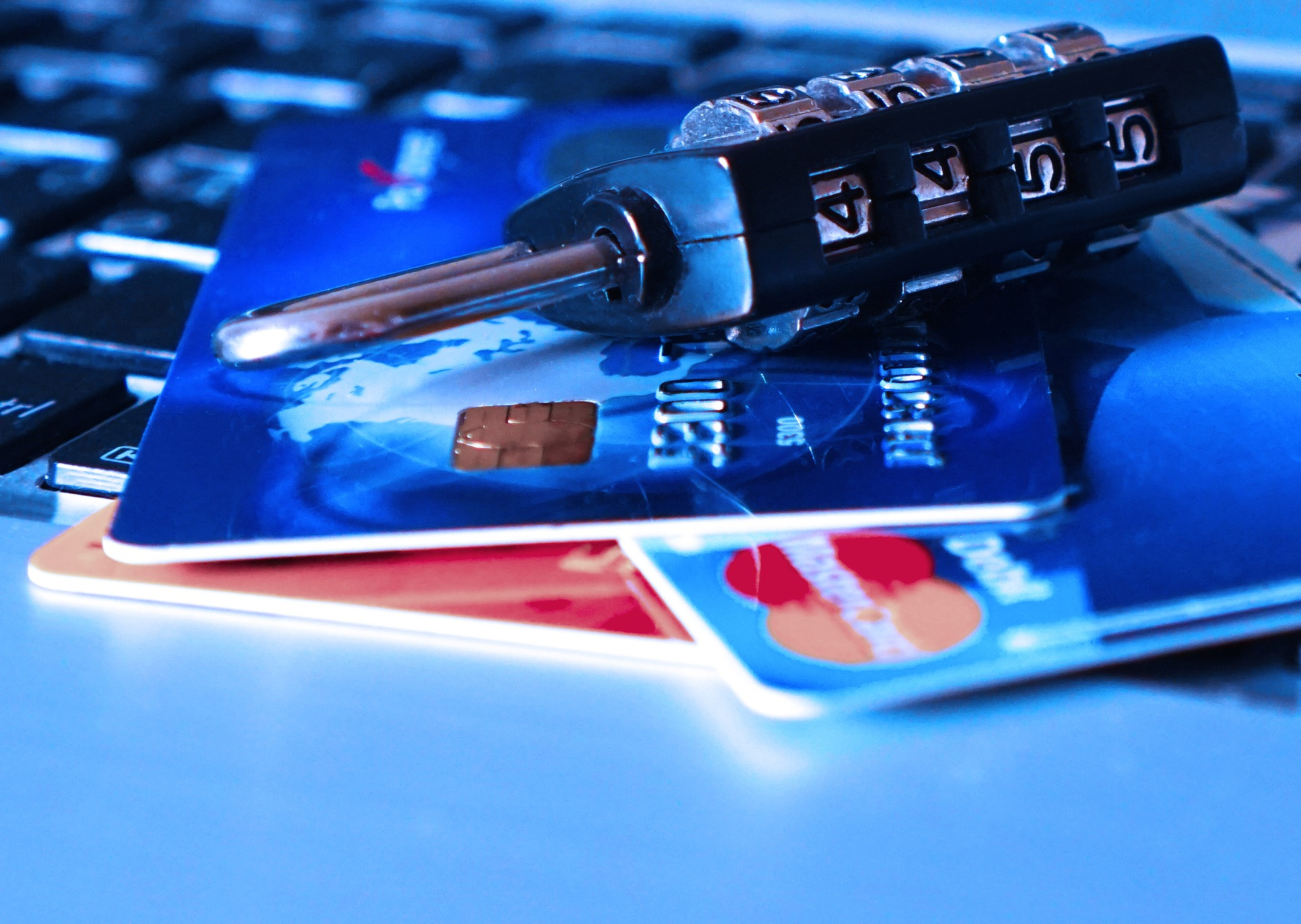 Credit cards stacked with a lock. ECommerce safety and credit card fraud prevention